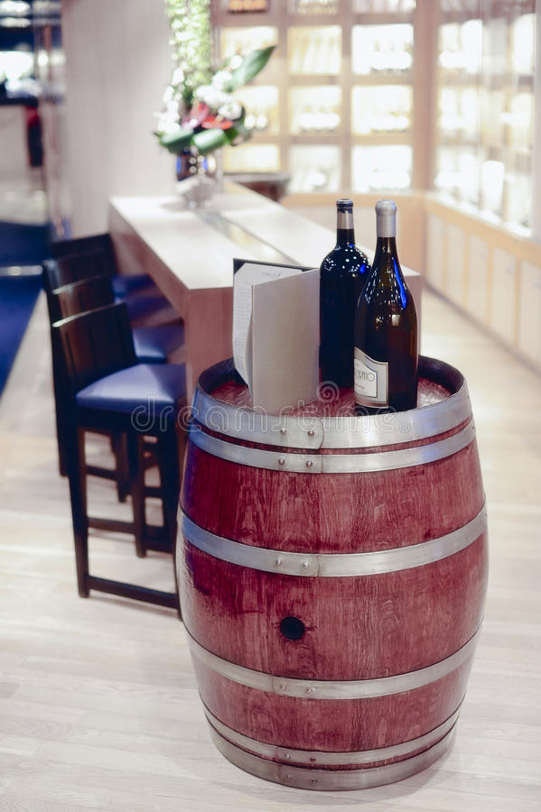 Wine bottles and barrel in winery cellar shop royalty free stock photo