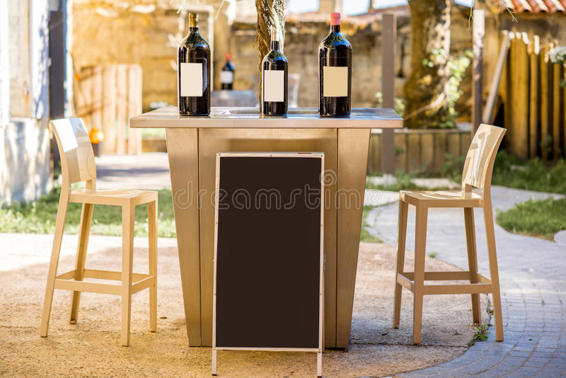 Wine bottles with blank label on the table stock photography