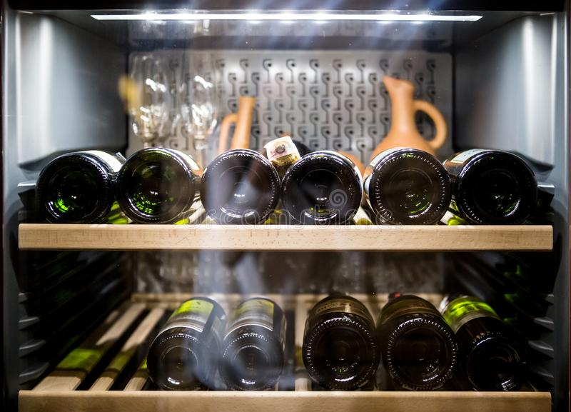 Wine bottles cooling in refrigerator.  stock image