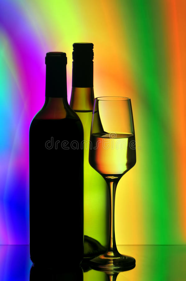 Wine bottles and glasses stock photography