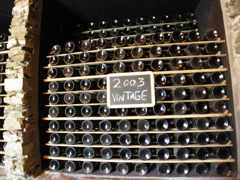 Wine bottles maturing vintage 2003 winemaking stock photos
