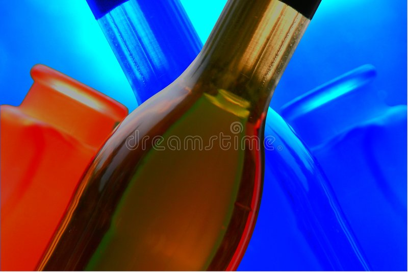 Wine bottles with reflections royalty free stock photography