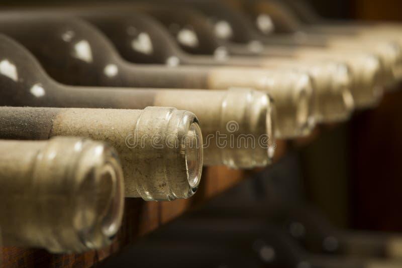Wine Bottles On Shelf Royalty Free Stock Photos