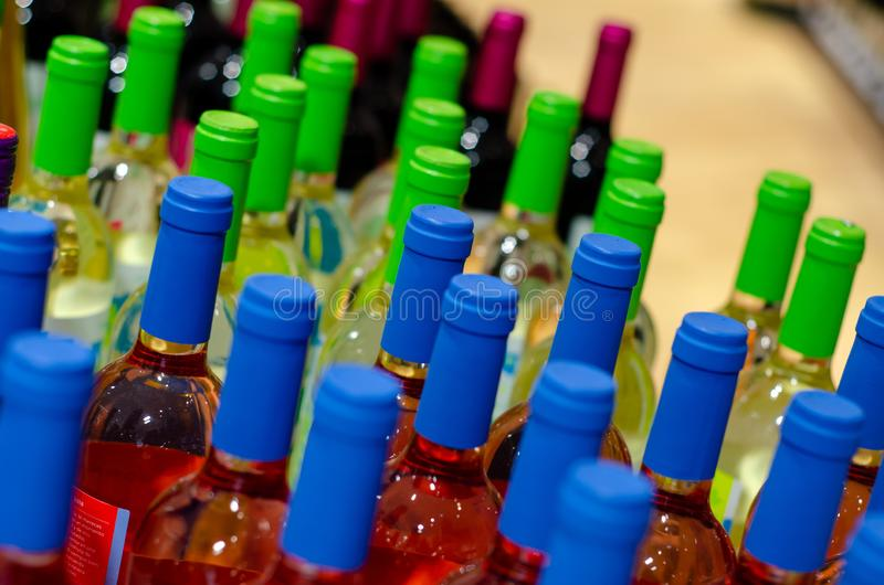Wine bottles in the wine store stock photos