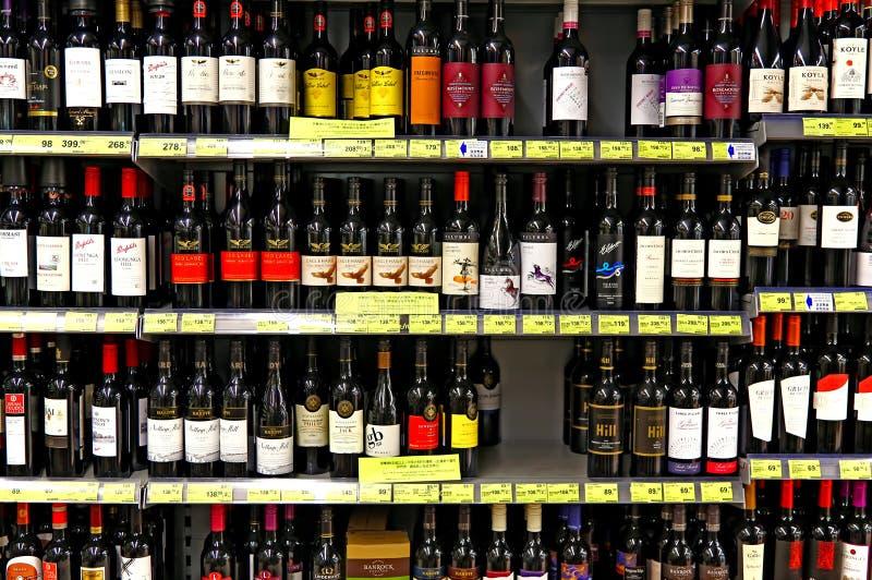 Wine bottles at supermarket stock photos