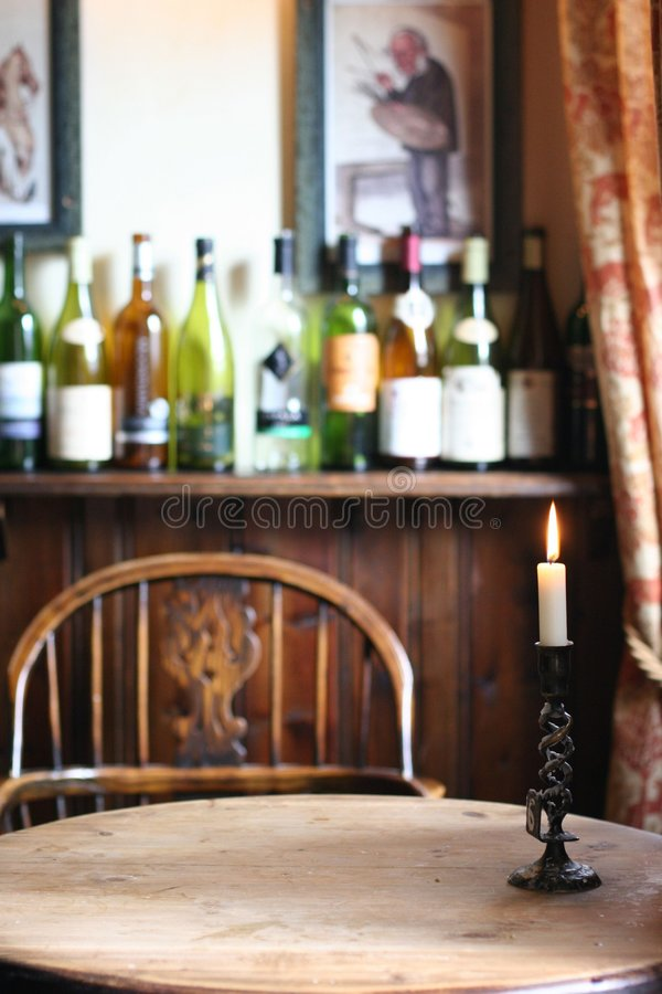 Wine bottles on table stock photo