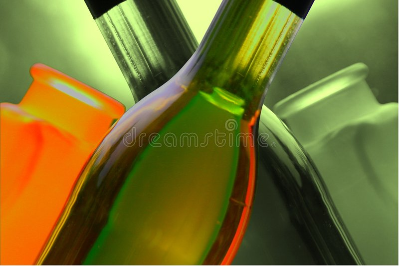 Wine bottles with vases royalty free stock photography