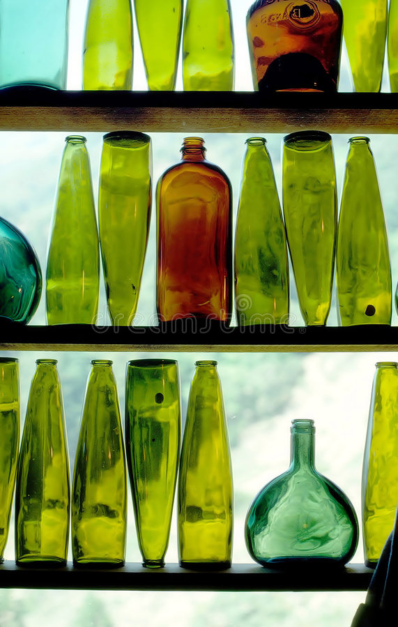 Wine Bottles in Window royalty free stock photography