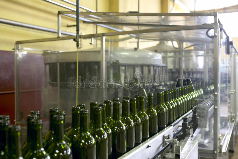 Wine bottling plant. Wine cellar automatic bottling process Spain horizontal stock photos