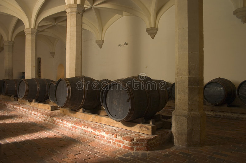 Wine casks in cellar. A collection of old wooden wine casks in cellar royalty free stock image