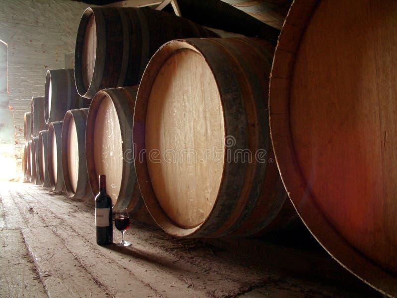 Bottle of wine on cellar floor stock photos