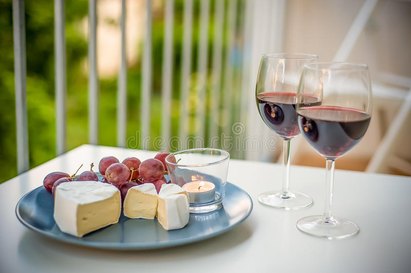 Wine and Cheese. An afternoon wine and cheese snack royalty free stock photography