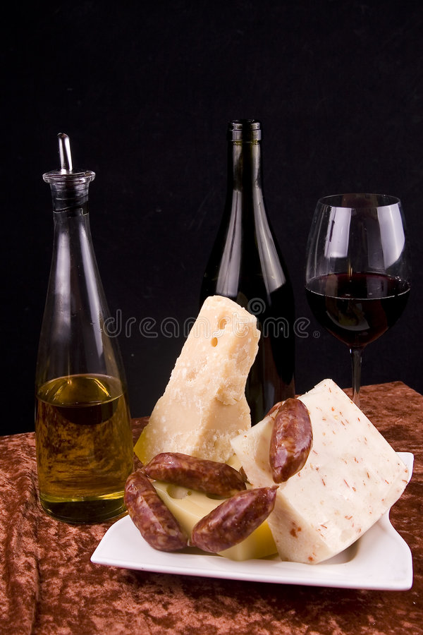 Wine and cheese appetizers stock photos