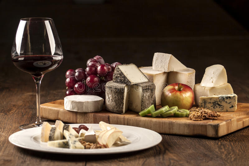 Download Wine And Cheese Plate Specialties Stock Image - Image of cheese delicatessen 29312977 & Wine And Cheese Plate Specialties Stock Image - Image of cheese ...