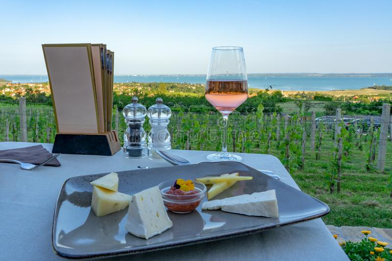 Wine, cheese table over the Lake Balaton on the hill Dinner, lunch, romantic date, picnic, eating on nature. Csopak wine royalty free stock image