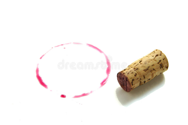 Wine and cork. Red wine ring and cork on white stock images