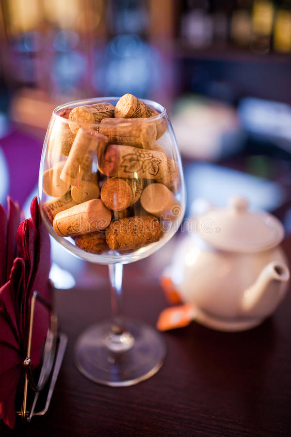 Wine cork in the glass. On restaurant stock image