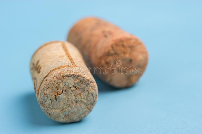 Wine cork and grape. On blue background royalty free stock image