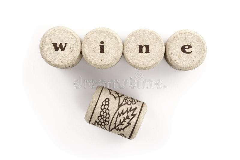 Wine cork. Word written over the corks on white background stock photos