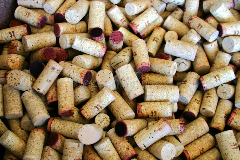 Wine corks. A barrel full of red wine corks stock photos