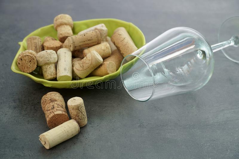 Wine Corks and empty glass on concrete table. royalty free stock photos