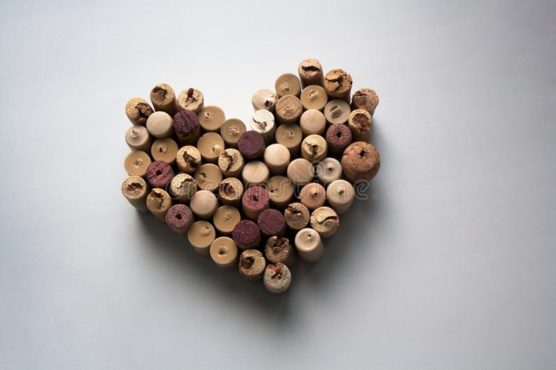 Wine corks heart shaped composition on white background stock image
