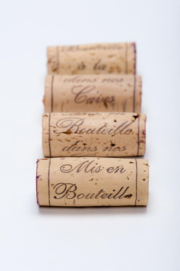 Wine Corks lined up on white. You can read Mis en Bouteille a la caves on them. Focus goes from the front to the back royalty free stock photography