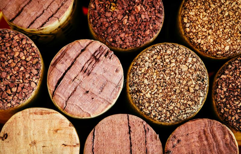 Wine corks side by side in a pile macro close-up background. The used corks display different hues, colours and textures stock photo
