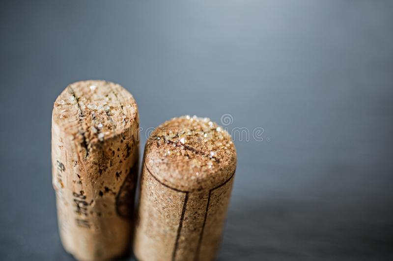 Wine corks with tartar crystals. Still life of wine corks with tartar crystals on slate grey background royalty free stock photos