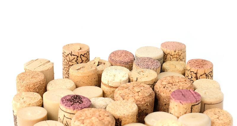 Wine corks on white background with the text area. Wine corks isolated on white background. Close up light composition with the place for text royalty free stock photo
