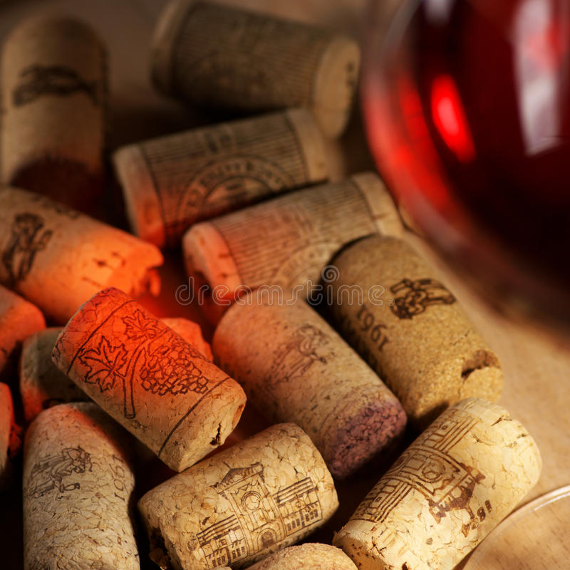 Wine corks with wine reflex stock images