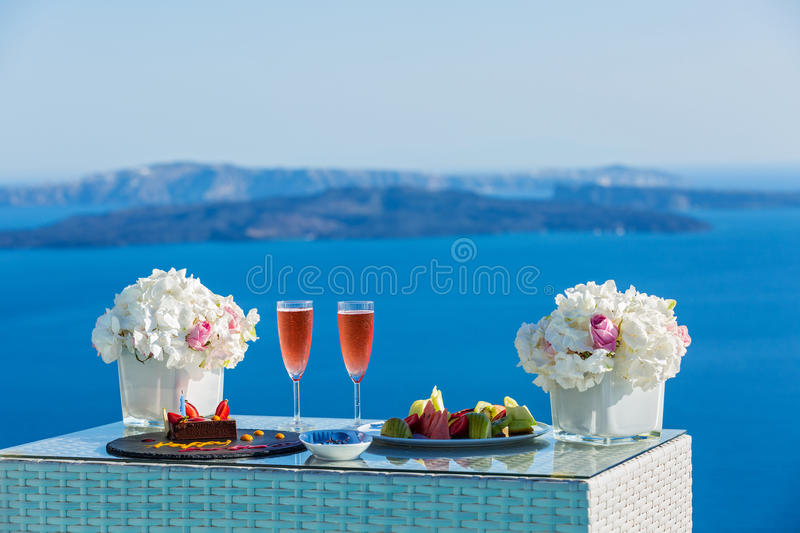 Wine and dessert for two on the beach stock images