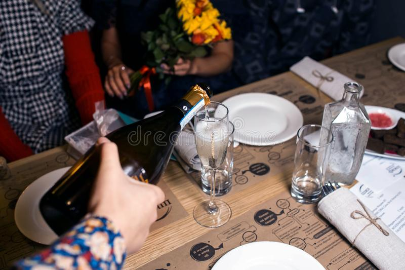Wine dinner at the restaurant with oysters and seafood. Oysters and risotto gourmet cuisine. Mussels for dinner. Russia,. Sverdlovsk, 19 October 2018 stock image