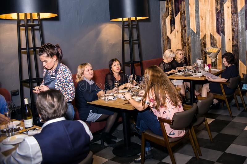 Wine dinner at the restaurant with oysters and seafood. People eat Oysters and risotto gourmet cuisine. Mussels for dinner,. Visitors first try oysters. Russia stock photos