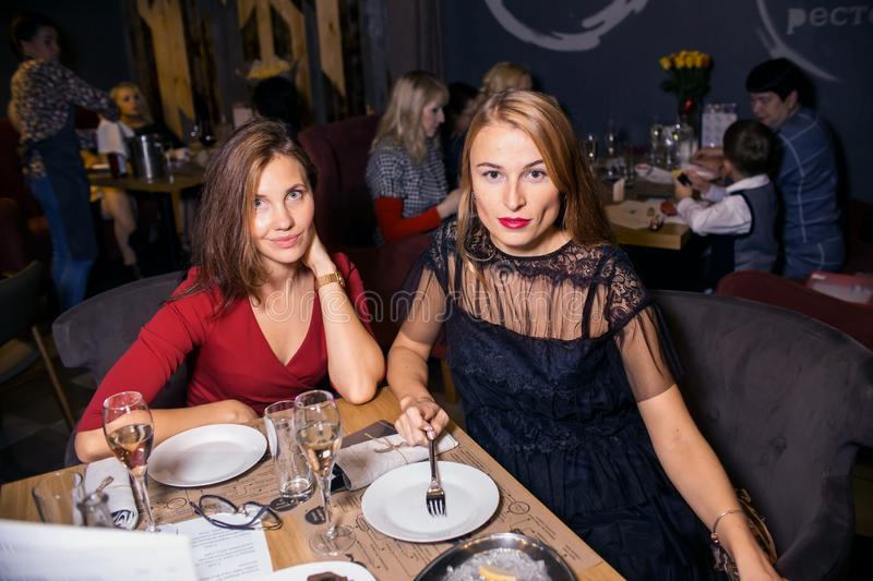 Wine dinner at the restaurant with oysters and seafood. People eat Oysters and risotto gourmet cuisine. Mussels for dinner,. Visitors first try oysters. Russia stock images