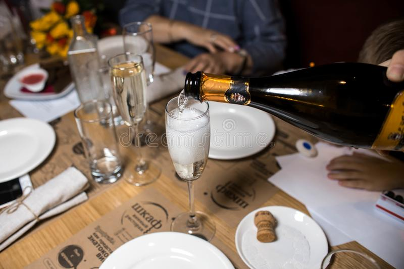 Wine dinner at the restaurant with oysters and seafood. Oysters and risotto gourmet cuisine. Mussels for dinner. Russia,. Sverdlovsk, 19 October 2018 stock photo