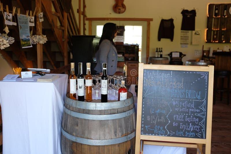 Wine display at tasting room, Harris Bridge Vineyard, Oregon. Wren, Oregon, May 2016: Wine varieties are displayed at tasting room at Harris Bridge Vineyard in stock photography