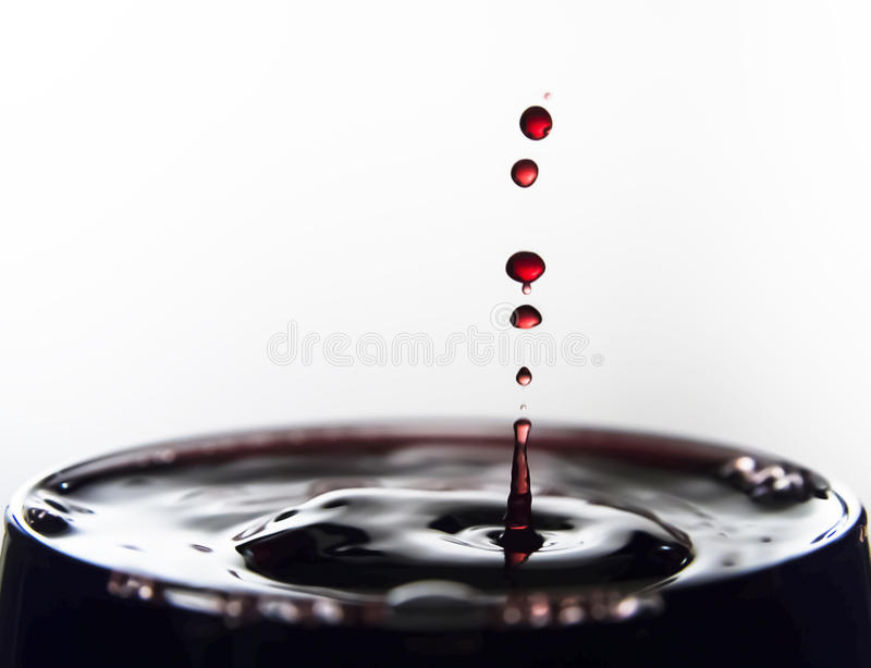 Wine drops. Splashing on glass stock photography