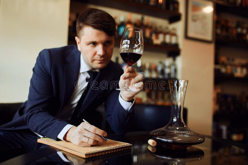 Wine expert working in the restaurant stock photography