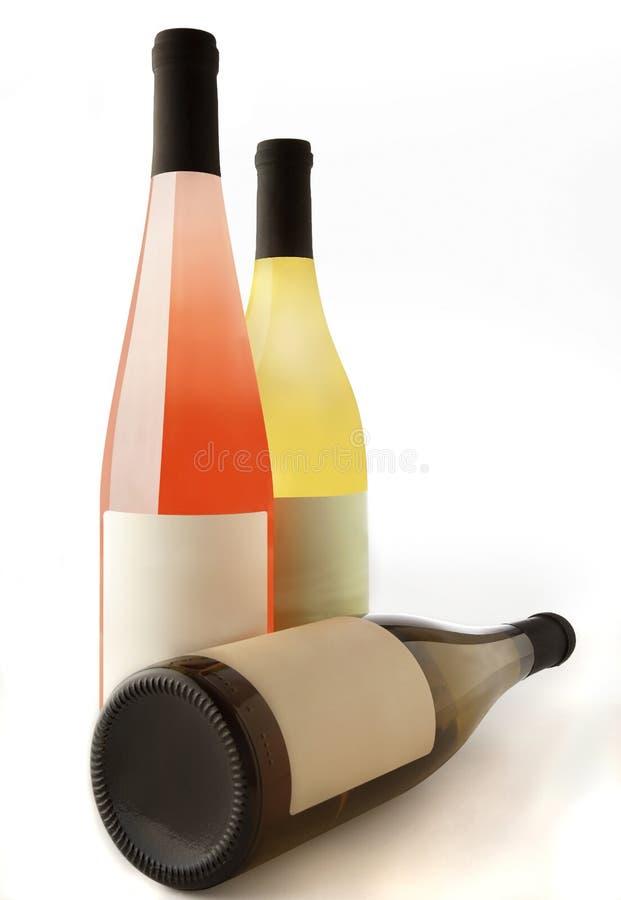 wine för flaskor tre arkivbild