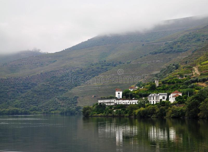 Wine farm reflected in water - Douro river stock photos