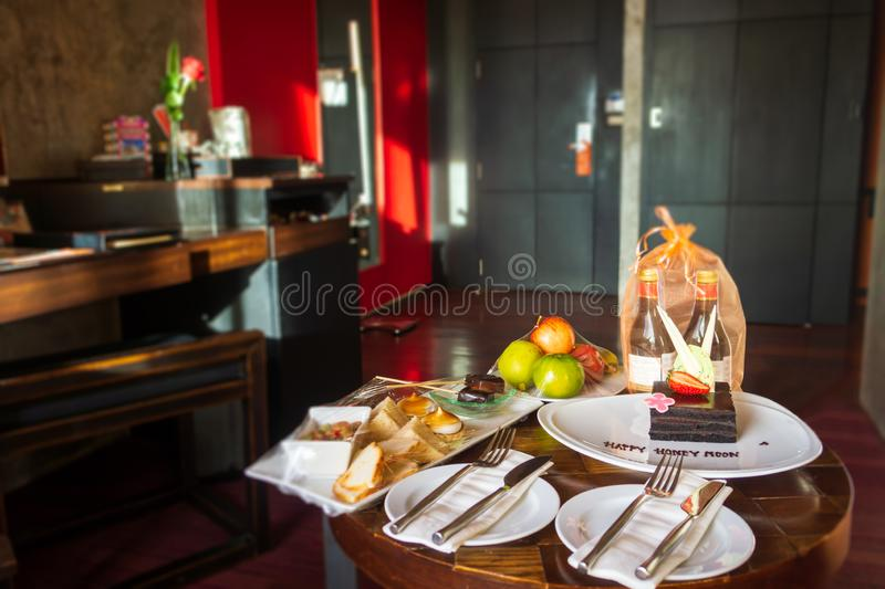 Wine, food and cake honeymoon welcome surprise, Thailand stock photos
