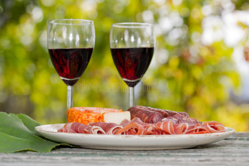 Wine and food. Red wine glasses and food outdoor stock photos