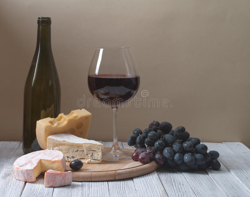 Wine and fresh cheese stock images