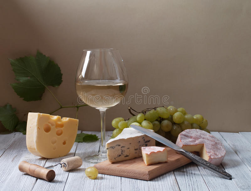 Wine and fresh cheese stock photos