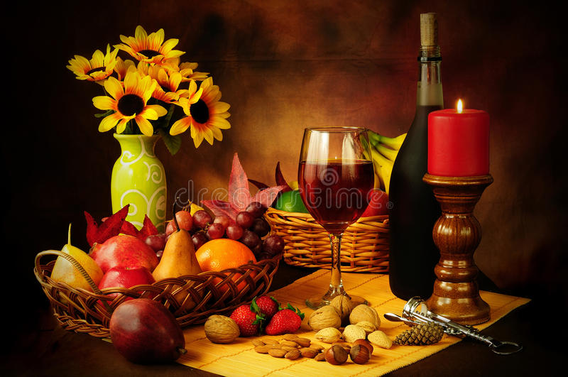 Wine, fruit and nuts still life royalty free stock image