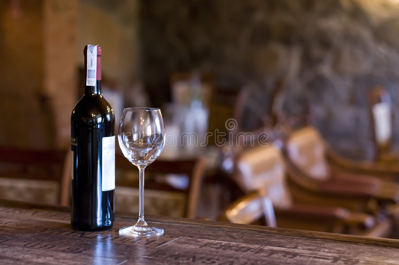 Wine and glass on the bar stock images