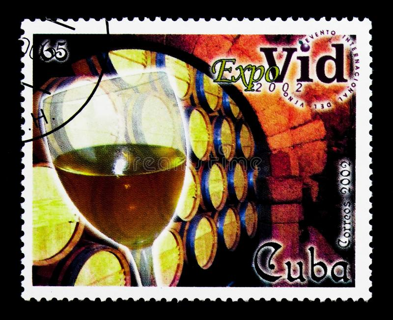 Wine glass and barrels, International Wine Festival Expovid 2002. MOSCOW, RUSSIA - MARCH 28, 2018: A stamp printed in Cuba shows Wine glass and barrels royalty free stock images