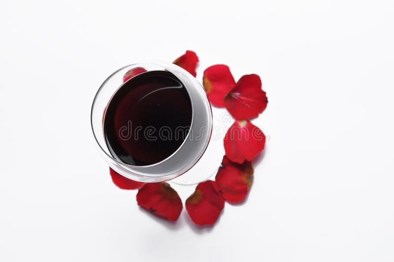 Wine glass and beautiful red rose  on white background. petals rose.Copy space royalty free stock photo