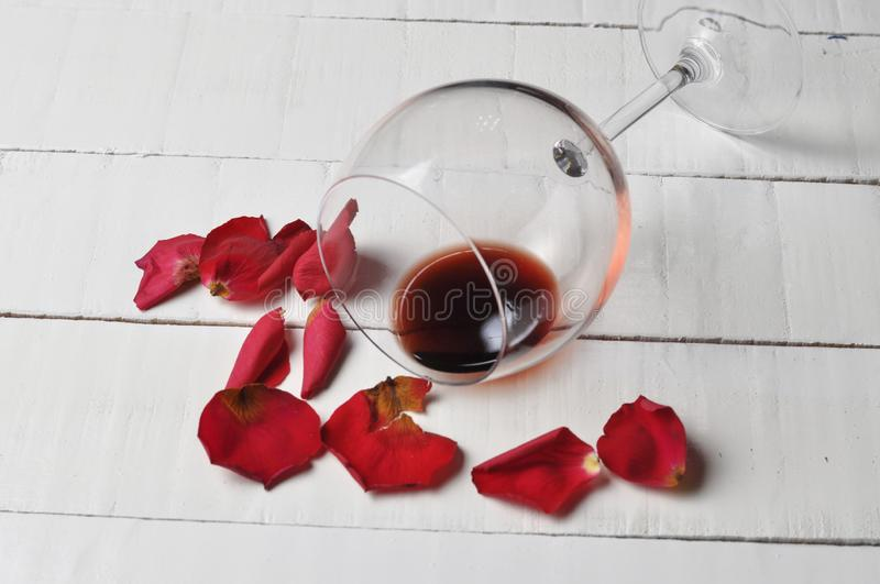 Wine glass and beautiful red rose isolated on white background. petals rose.Copy space stock photography